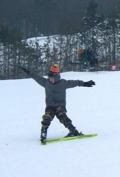 boy skiing down hill