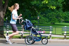 mom jogging while pushing stroller
