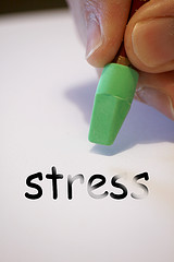 person erasing the word stress