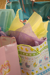 gift bag with purple and yellow tissue showing