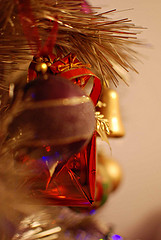 gold and red christmas ornaments hanging on tree