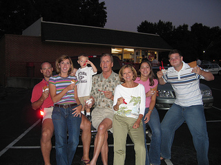 family posing together holding ice cream