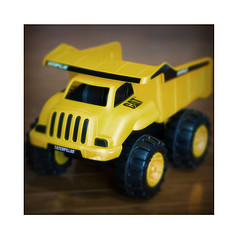 yellow toy dump truck