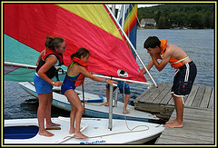 kids climbing on to a sailboat
