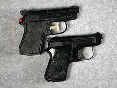 two handguns, one real and one toy