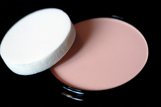 cream makeup and sponge applicator