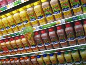 shelf of juice in a grocery store