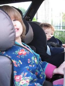 toddlers in car seats in car