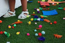 child's feet near craft supplies