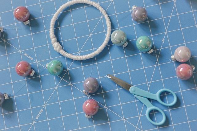 beads, scissors, and bracelet lying on cutting mat