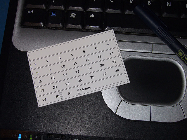 card with calendar on it lying on a computer