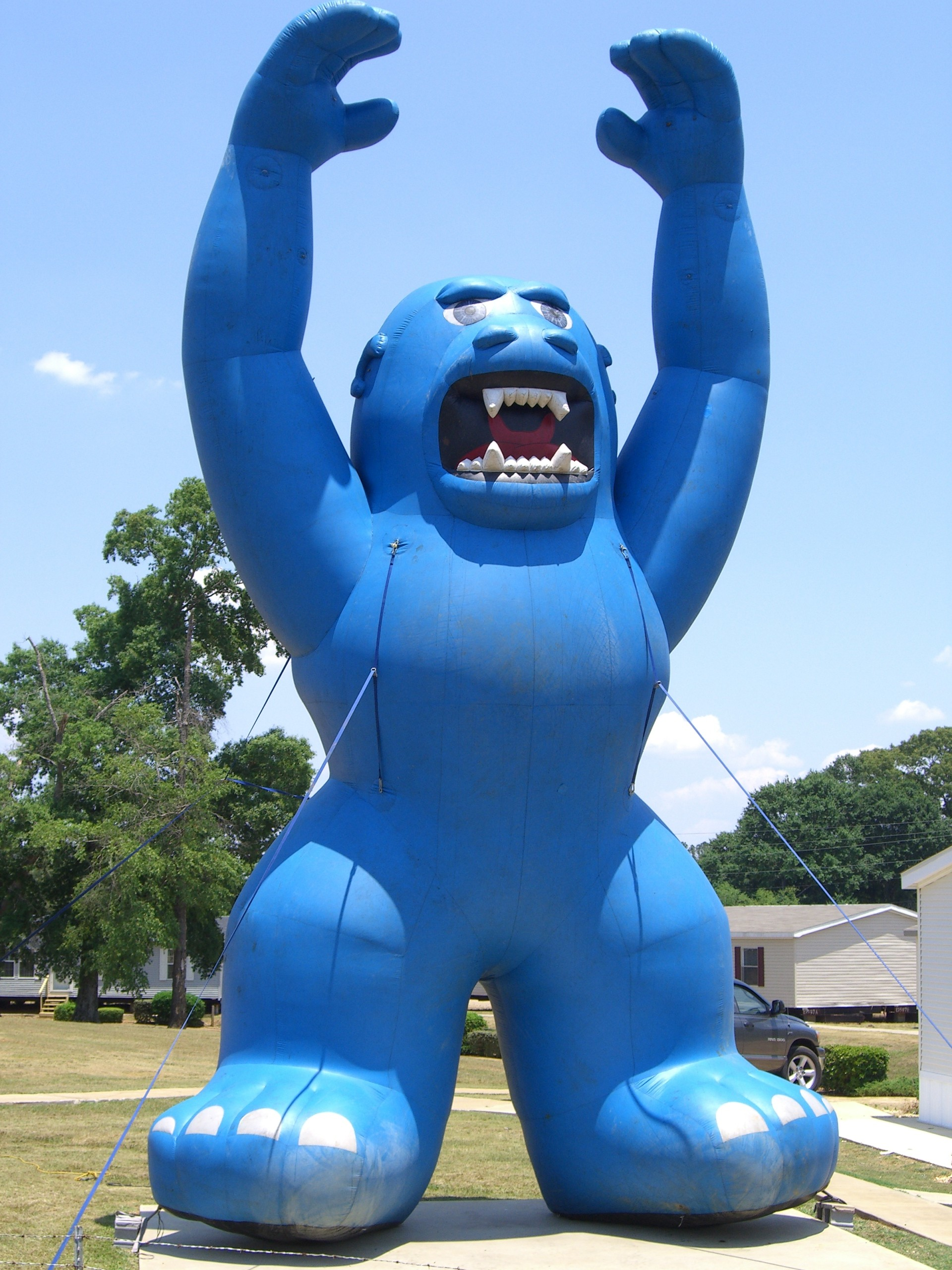 blue inflatable gorilla used at businesses for marketing
