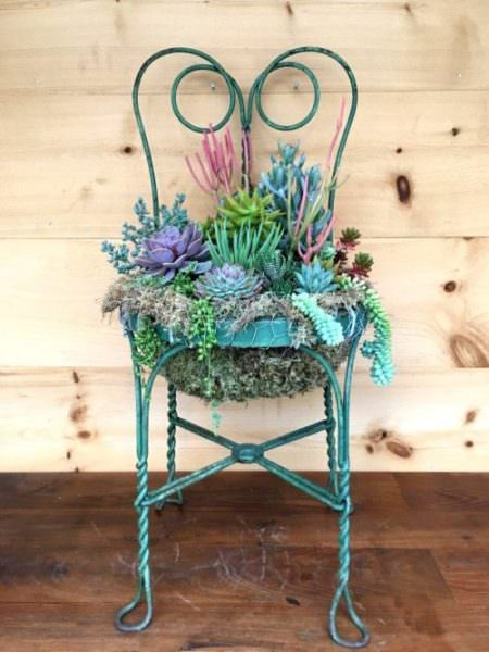 iron chair frame repurposed into planter