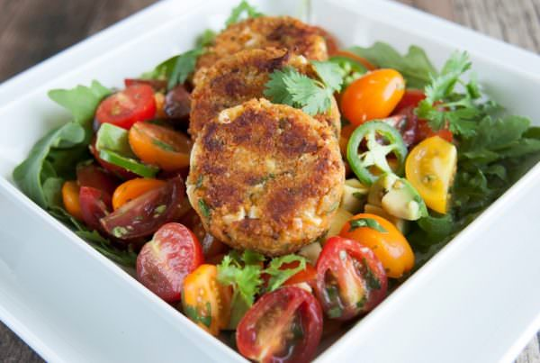 Quinoa sweet potato cakes with avocado and heirloom tomato salad