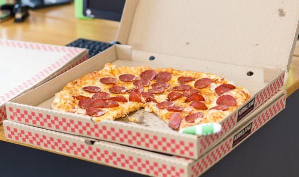 pepperoni pizza in open corrugated cardboard box