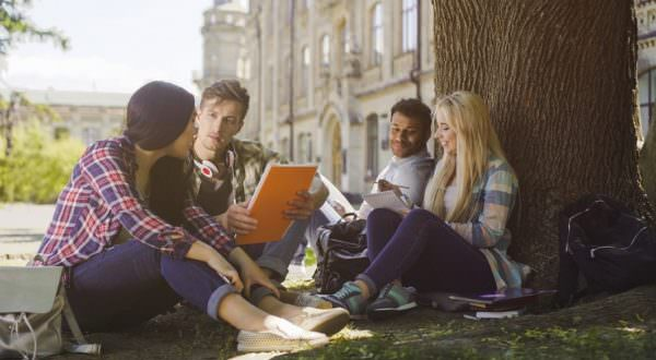students talking outside on college campus
