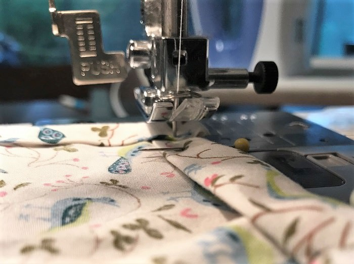 Sew a straight hem, picking up the sewing machine foot before you turn each corner.