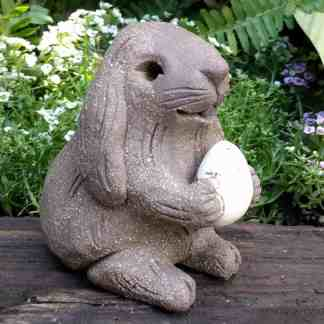easter_bunny_holding_egg_ears_down_small_4