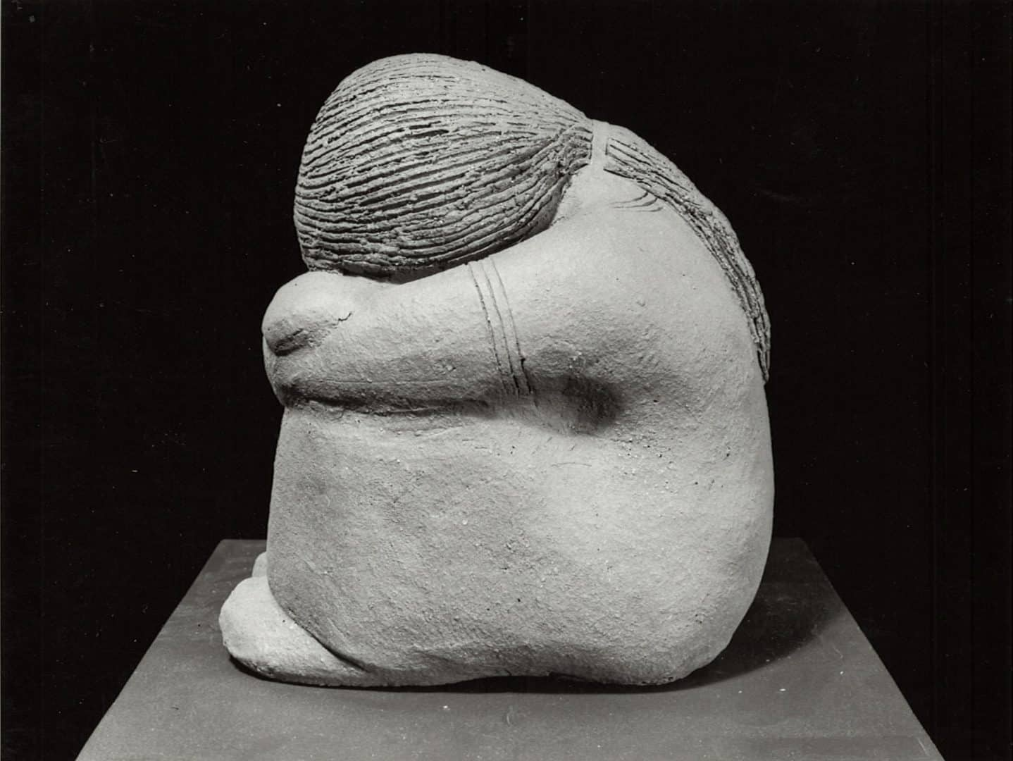 guatemalan-woman-hunched-over-sculpture-by-margaret-hudson