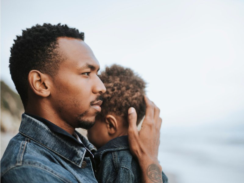 Man Holding Child with Love, African American