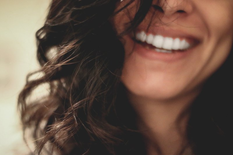 women smiles with self love