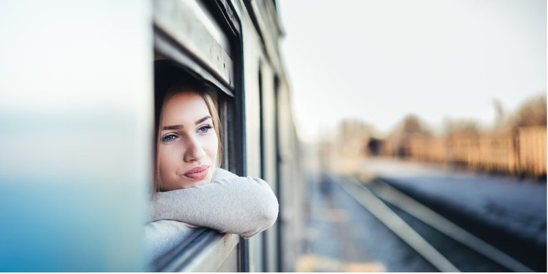 Self-Reflexive Awareness, Woman Looks out Train Window with Relaxed Reflexivity