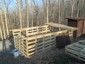 "From the rear. Here you see how we scabbed together 3 pallets to use as ""rafters"" to mount the metal roofing too."