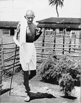 Gandhi outside his hut in Sevagram, the last community he 'made', he had gone there to get away from his old hangers-on, to see for himself what one person could do for village uplift, but the crowds soon followed....