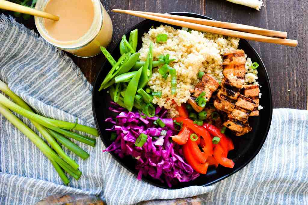 A grain bowl plated, with peanut dressing