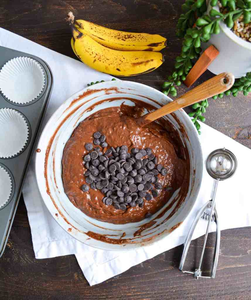Double Chocolate Banana Muffin batter in a bowl with a scoop