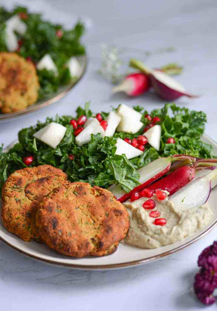 Plate of falafel with baba ganoush and salad