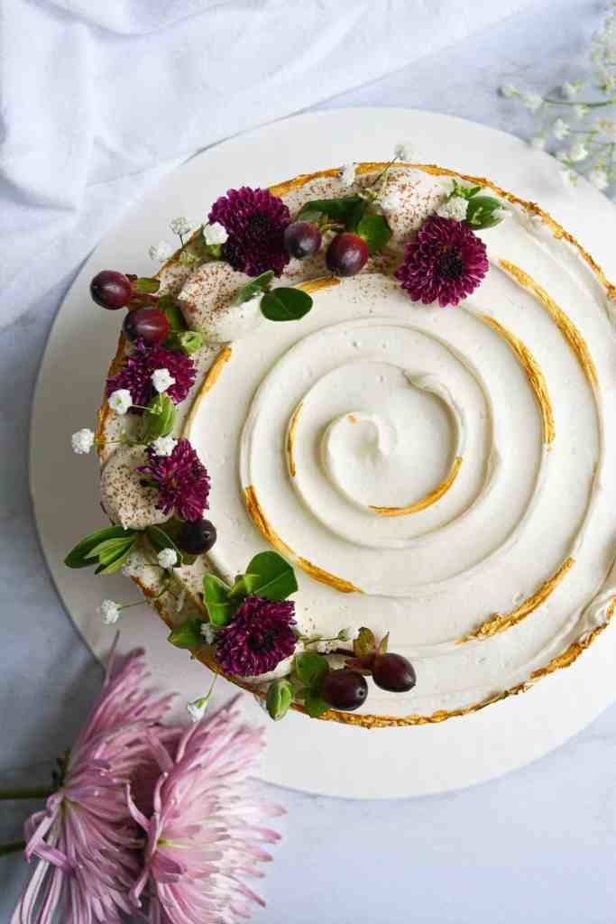 Honeycrisp Apple and Spice cake decorated with berries, flowers and gold accents