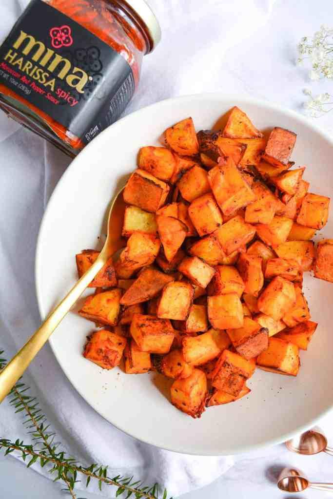 Overhead shot of a bowl of Crispy Harissa Roasted Potatoes
