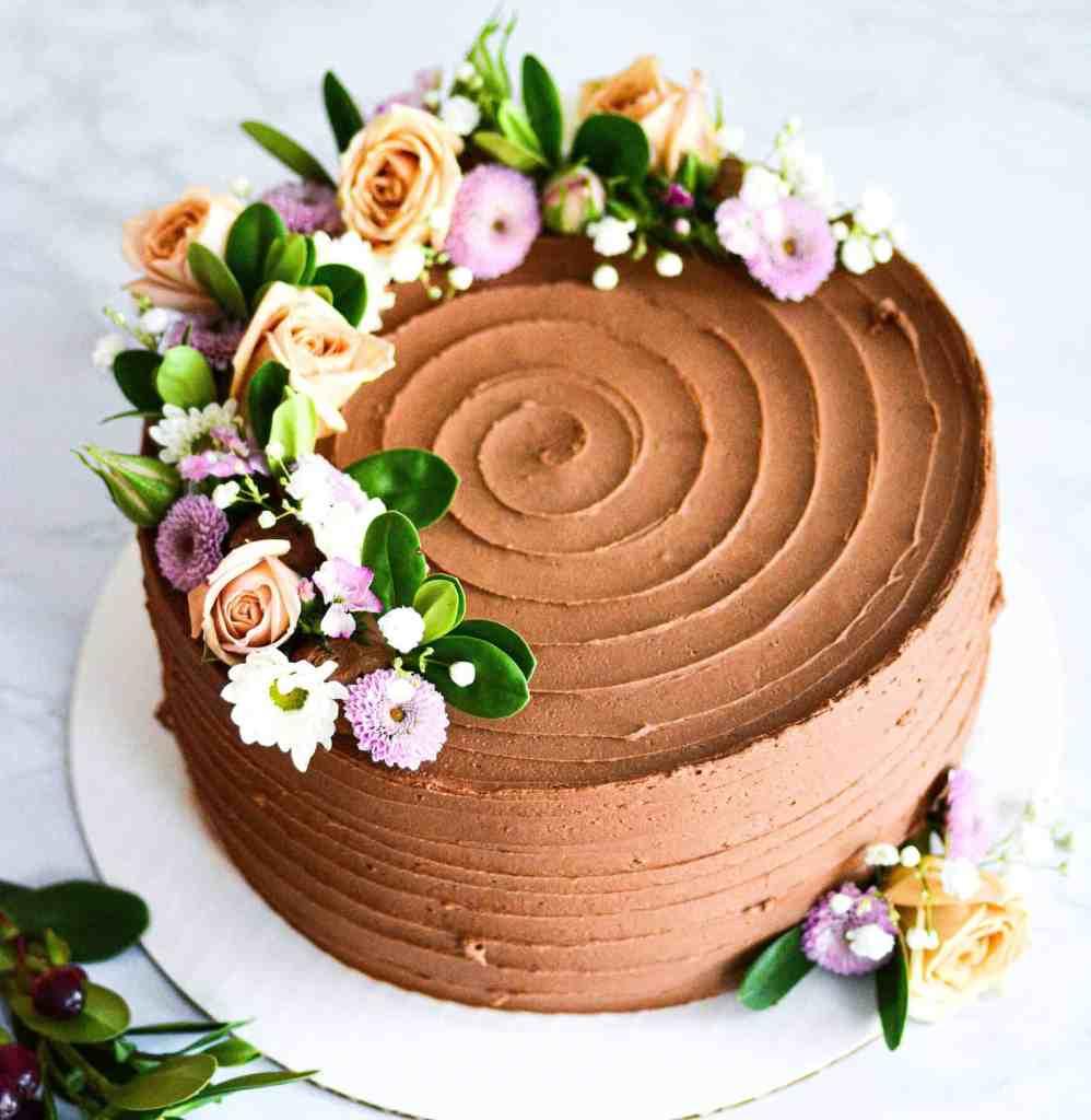 Chocolate vegan wedding cake with flowers for a boston wedding