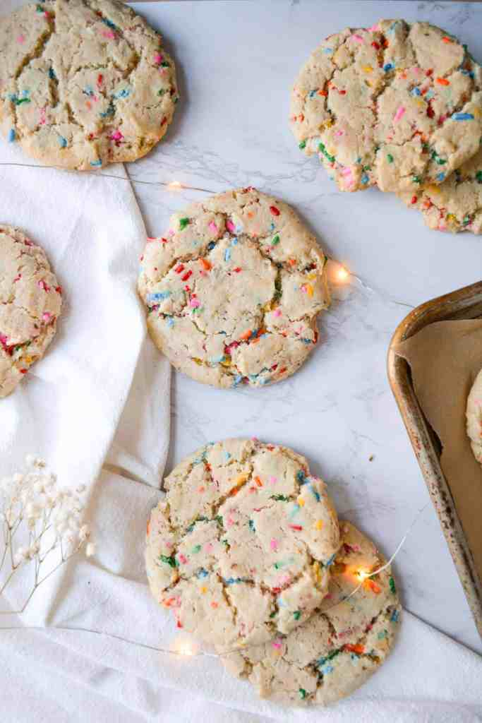 Overhead shot of Funfetti Sugar Cookies laid out on a marble board