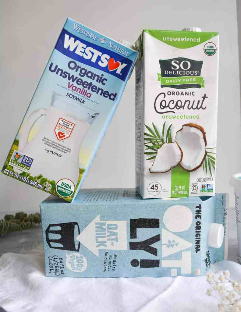 The best vegan milk products. A box of oatly, so delicious coconut milk and westsoy soymilk
