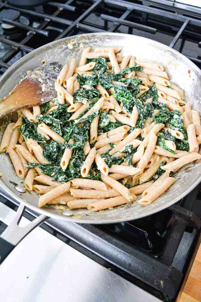 Creamy Garlic Pasta with Kale in a skillet