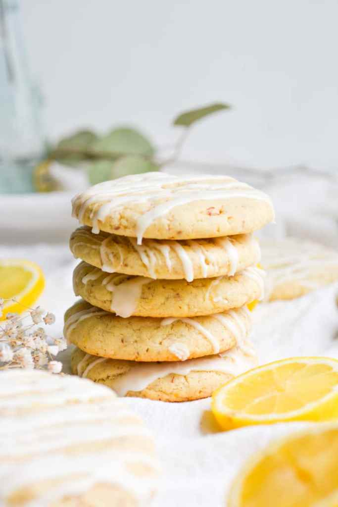 5 Vegan Lemon Cookies stacked on a white board