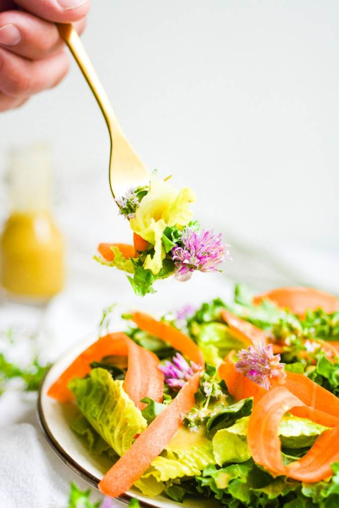 Fork with salad on it