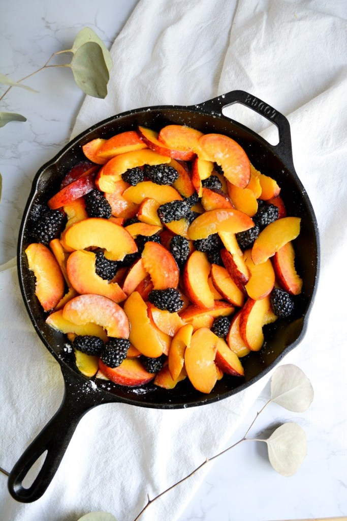 Peaches and blackberries in a cast iron skillet