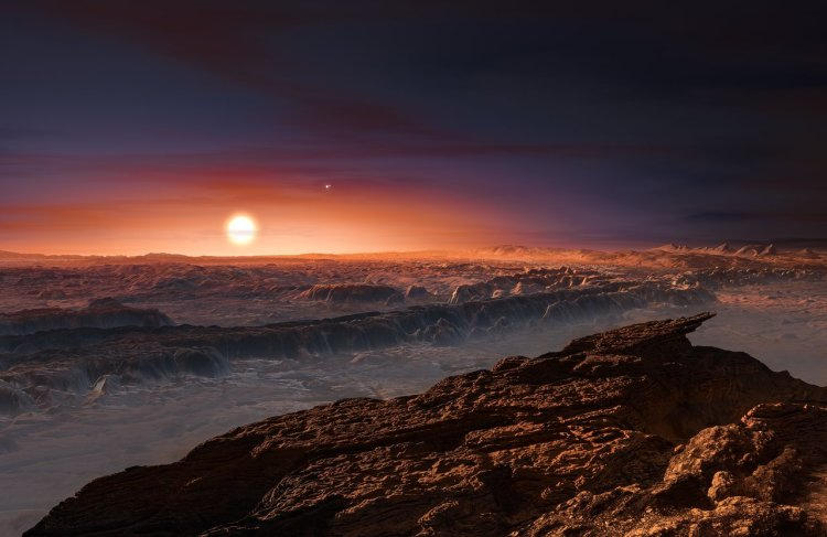 An artist's impression of the planet Proxima Centauri b. Located in the nearest solar system to our own, Proxima Centauri b is not likely to have a habitable surface due to extremely high radiation. The two smaller stars in the background are Alpha Centauri A and B, two sun-like stars that, combined with Proxima Centauri, make up a triple-star system.