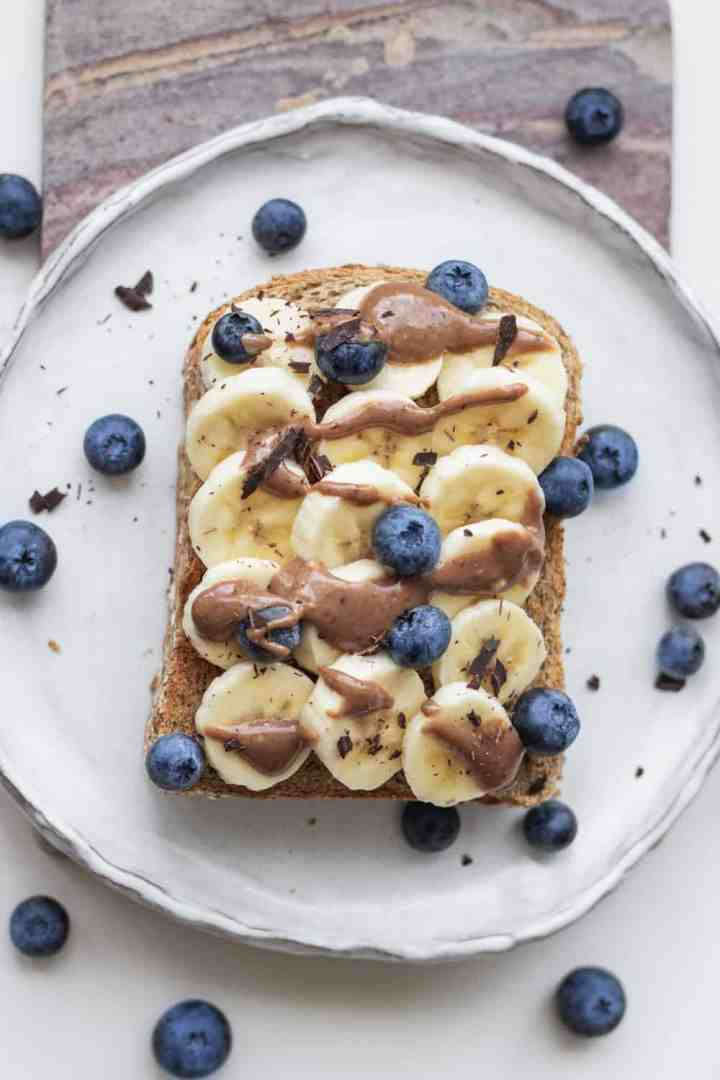 Banana on toast with a chocolate yoghurt sauce and blueberries