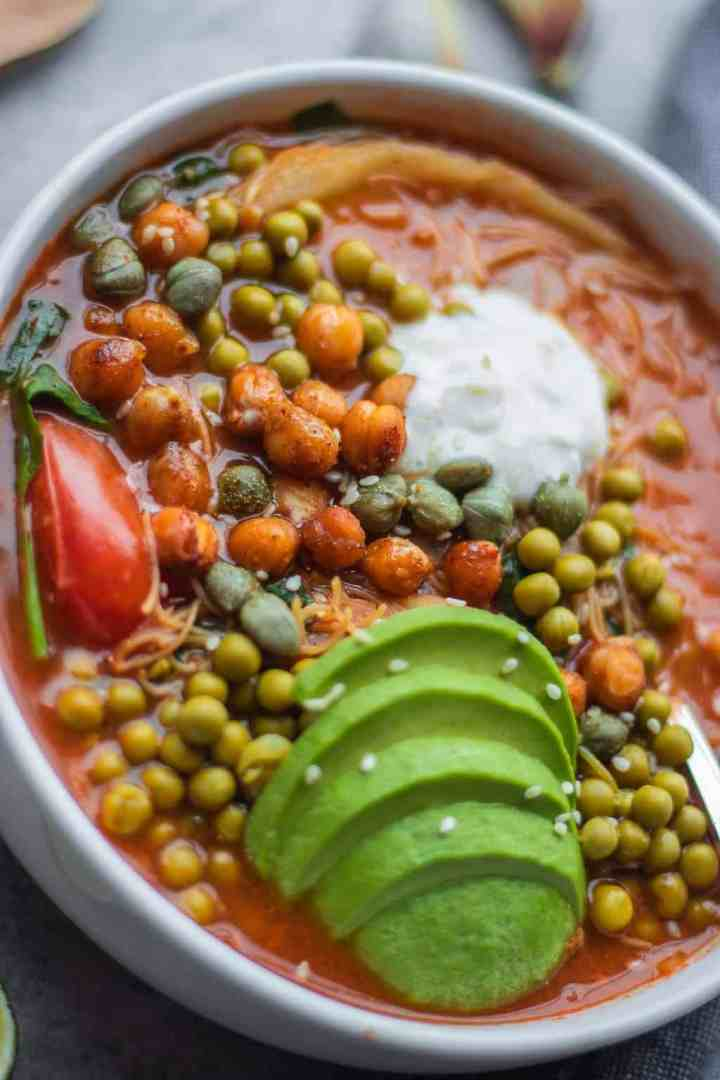 Chickpea vegetable rice noodle soup in a bowl