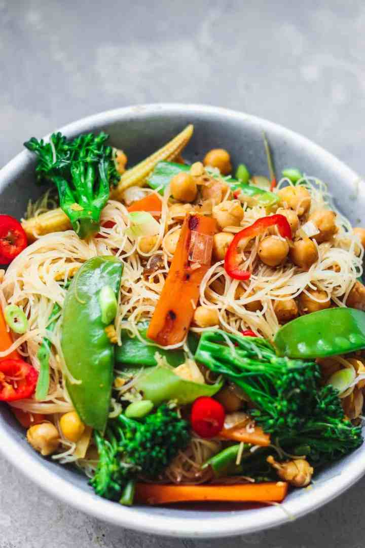 Bowl of vegan stir-fry with noodles chickpeas and vegetables