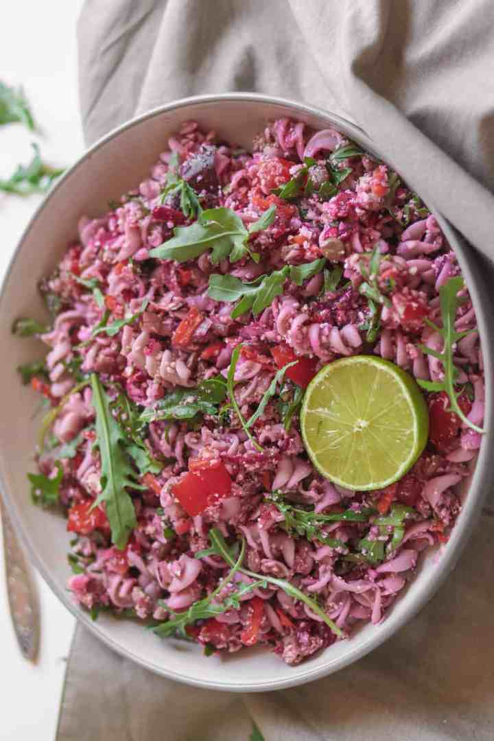 Pink beetroot pasta salad made with fusilli, lentils and a peanut butter dressing