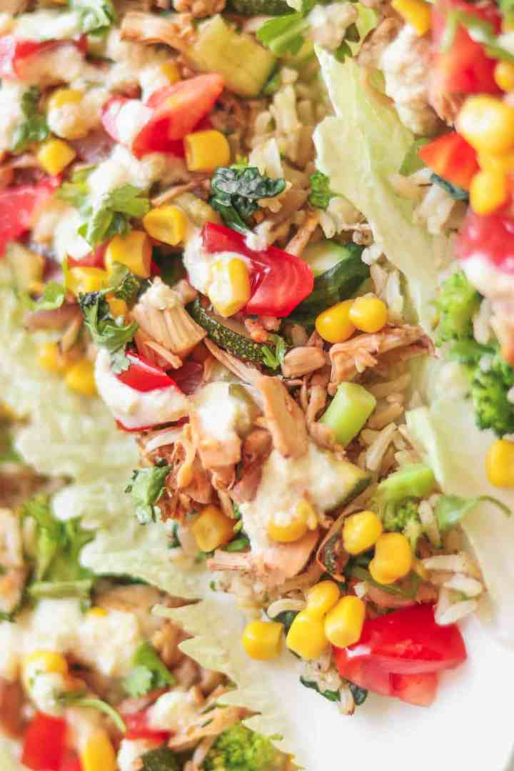 Closeup of jackfruit and brown rice lettuce tacos