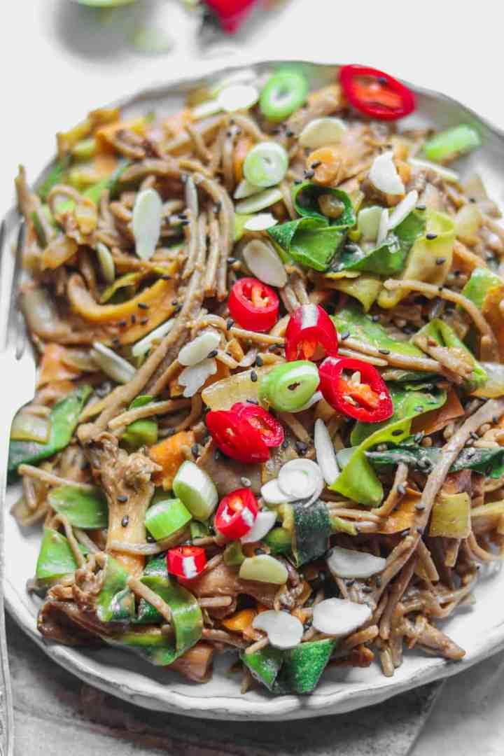 Vegan soba noodle stir-fry with oyster mushrooms and miso tahini sauce