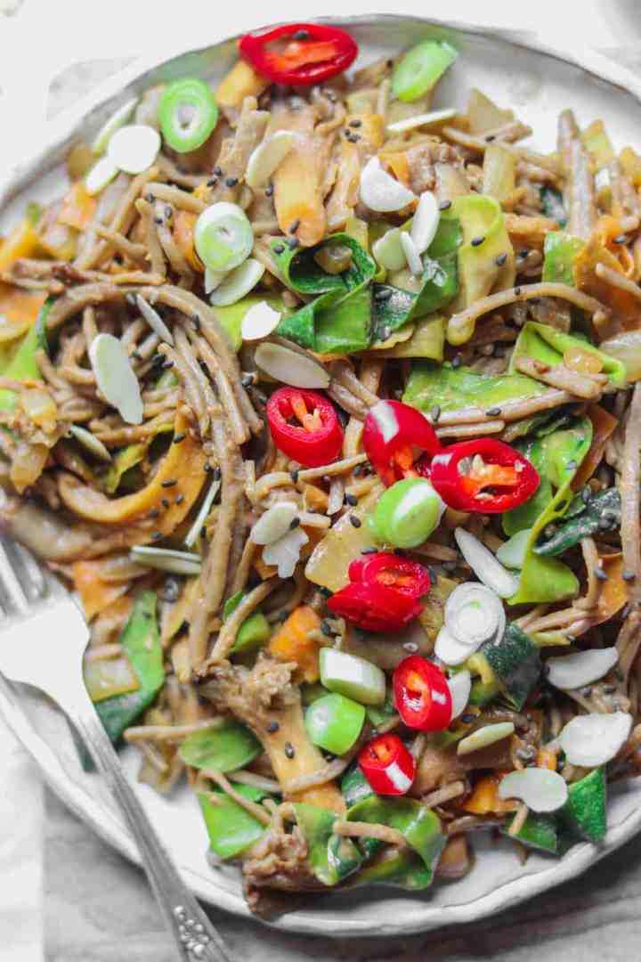 Plate of miso tahini soba noodle stir-fry with oyster mushrooms and vegetables