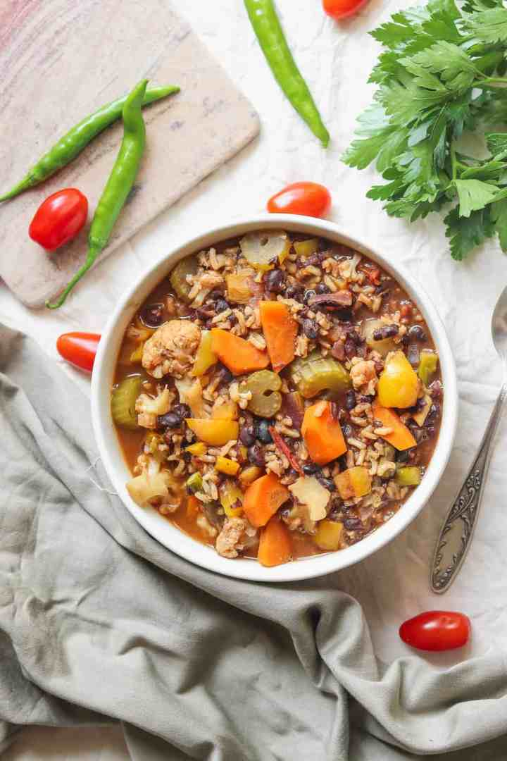 comforting vegan rice soup with vegetables and black beans