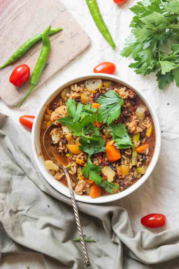 healthy vegan soup with rice, black beans and vegetables